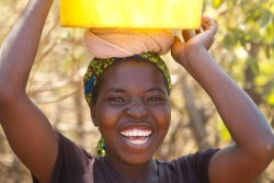 Gugulethu  Ngwenya smiles  while fetching water from a borehole  source in Umzingwane  District near Bulawayo in this Wednesday, August, 30, 2017 photo. The  district is set to benefit from a programme which is aimed at rehabilating  various water points  and boreholes in a bid to  provide access to clean water to households within the community. UNICEF Zimbabwe  and other partners  have taken a lead in identifying  and assisting these communities in need  of Non Food Items( NFI )benefits(Copyright/ Tsvangirayi Mukwazhi/UNICEF ZIMBABWE)