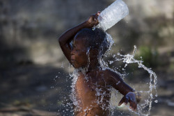 On 24 March 2019 in Mozambique, a child washes himself with dirty water in an area that was flooded after Cyclone Idai made landfall in Beira. Tropical cyclone Idai, carrying heavy rains and winds of up to 170km/h (106mp/h) made landfall at the port of Beira, Mozambique's fourth largest city, on Thursday 14 March 2019, leaving the 500,000 residents without power and communications lines down. On 19 March 2019, the Government of Mozambique declared a national emergency and three days of national mourning due to the devastation caused by Cyclone Idai and the subsequent flooding in the central region. On 23 March 2019, according to initial government estimates, 1.8 million people across the country, including 900,000 children, have been affected by the cyclone which slammed into the country last week. However, many areas are still not accessible and UNICEF and partners on the ground know that the final numbers will be much higher. UNICEF is concerned that flooding, combined with overcrowded conditions in shelters, poor hygiene, stagnant water and infected water sources, is putting them at risk of diseases like cholera, malaria and diarrhoea. Initial assessments in Beira indicate that more than 2,600 classrooms have been destroyed and 39 health centers impacted. At least 11,000 houses have been totally destroyed. In Beira, Fore visited a school which had turned into a shelter for displaced families. Classrooms were converted into overcrowded bedrooms with limited access to water and sanitation. A UNICEF warehouse was severely damaged in the cyclone, causing the loss of essential supplies that had been pre-positioned before the cyclone made landfall. Cyclone Idai started as a tropical depression in Malawi, where it forced families from their homes into churches, schools and public buildings. Nearly half a million children are affected. After Mozambique, the cyclone moved to Zimbabwe where it caused significant damage to schools and water systems. Children need to re