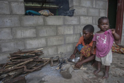 On 18 March 2019 in Malawi, Nesi Kennedy, 20, and her daughter, Florah, 3, have been displaced by floods from their Biyasi Village, Group Village Headman Thaundi are staying in Nyachilenda School IDP camp in the area of Traditional Authority Ndamera in Nsanje District in Southern Malawi. On 5 March 2019, a tropical cyclone formed in the Mozambique Channel and drifted to Malawi, causing heavy rains accompanied by strong winds. The heavy and persistent rain led to severe flooding across some districts in southern Malawi. Following the devastation caused by the heavy rains and floods, the President declared a state of disaster on 8 March 2019 in the affected areas of the country. The President called upon local and international organisations to join the Government in providing relief support to the affected population.  More than 739,8001 people have been affected, including more than 75,900 displaced, with 56 deaths and 565 injuries recorded, according to the Government. The displaced are in 187 camps, mostly located in schools. Fourteen districts have been impacted. Key districts include Nsanje District, which recorded 81,000 people affected and 17,400 displaced, Phalombe, which recorded 88,372 people affected and 22,487 people displaced, and Chikwawa, which reported 68,010 affected and 39,875 displaced. The Government's Department Of Disaster Management Affairs (DoDMA) deployed search and rescue teams to the hardest hit Nsanje district. Furthermore, DoDMA deployed an Interagency Assessment team to Nsanje and Phalombe districts to gather more information about the situation, so as to better inform the humanitarian response.  The heavy rains and floods have likely impacted agricultural activities, as fields are inundated, and recently planted crops have been destroyed.