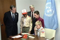 In an office at UNHQ, (left-right) UNICEF Executive Director James Grant, boy scout Brian, Under-Secretary-General Jan Martensen, UNICEF Goodwill Ambassador Audrey Hepburn and boy scout Michael make a collective telephone call to children at UN offices in Geneva, Switzerland, to announce the adoption of the United Nations Convention on the Rights of the Child that day. On receiving the news, the children in Geneva held a torch-lit procession through the city streets. UN Photo #275928 On 20 November 1989 at United Nations Headquarters (UNHQ), the UN Convention on the Rights of the Child was adopted by the UN General Assembly, after ten years of negotiations and debate. To celebrate this historic achievement, 500 children from around the world gathered to celebrate, joined by UN Secretary-General Javier Perez de Cuellar, UNICEF Goodwill Ambassador Audrey Hepburn, UNICEF Executive Director James Grant, UN delegates, NGO representatives and the media.