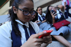 On 11 March 2016, Jan, 16, a student at St. Francis of Assisi School, and other girls, check their smart phones after classes in the Central Visayas city of Cebu, Philippines. Social media is a huge influence in children's lives and being constantly connected to the Internet also comes with many risks, including online sexual exploitation, of adolescents and children. After the loss of her grandfather, together with the pressures of adolescent life, Jan battled depression, and was a victim of cyber-bullying. Like many adolescents, she turned to the Internet for help. She saw a social media post about 'cutting,' a form of self-injury, and how the post described it as being an effective way to deal with pain and she tried it. She sought help from a UNICEF-supported programme on CyberSafety providing guidance and training in social media and she now works with UNICEF to help educate her peers about online safety. Worldwide, children make up one-third of all Internet users. With the rapid expansion of information and communication technologies, protecting children online is an urgent global priority. Among Filipino youth, more than half regularly use the Internet on own devices with easy and unrestricted online access. The lack of awareness of online safety, along with children's natural inquisitiveness, adolescent sexual curiosity and susceptibility to peer influence, makes children vulnerable to online violence, sexual abuse and exploitation. This can manifest itself in cyberbullying, sexual solicitation online, and victimization through child sexual abuse material and live stream child sexual abuse.  Online sexual abuse and exploitation may involve both contact and non-contact offenses, and often involves subtle forms of manipulation in which a child is coerced into these situations without being able to fully comprehend what is happening to them or give informed consent.  While poverty in the Philippines, and a culture of silence in relation to child sexu